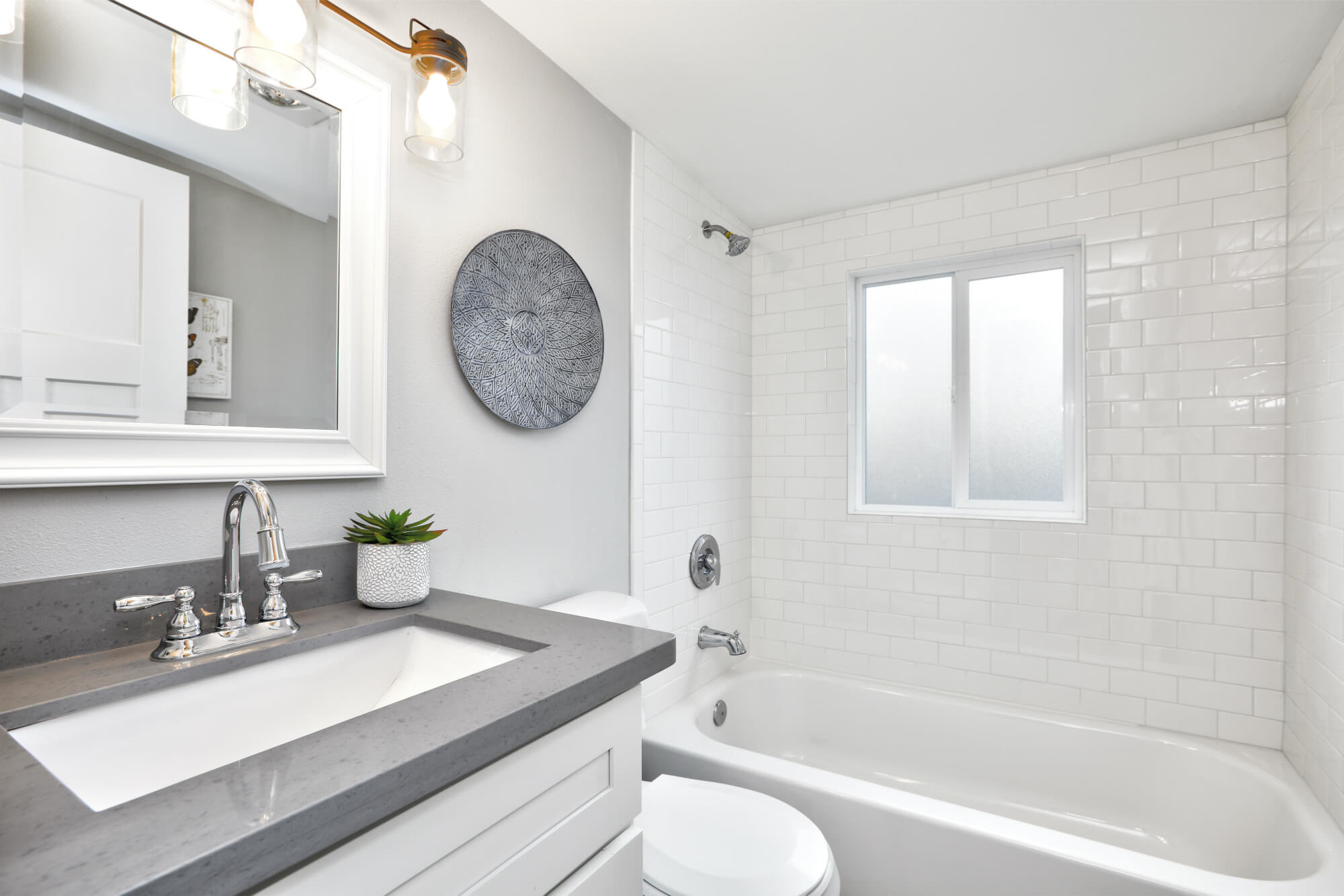 Modern clean bathroom in whites and grays in Charleswood Calgary home for sale